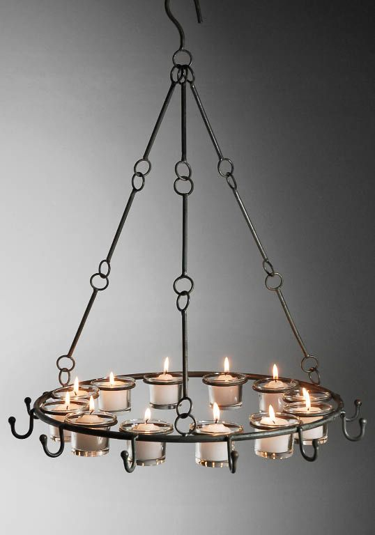 Metal Candle Chandelier...gorgeous hanging from a tree, draped with vines or flexible leafy branches at an outdoor event. #eventlighting