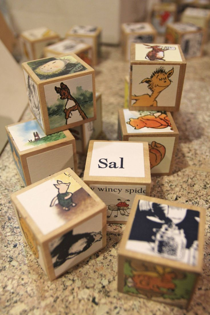 Decoupaged story book pictures onto wooden blocks for a book-themed baby shower!