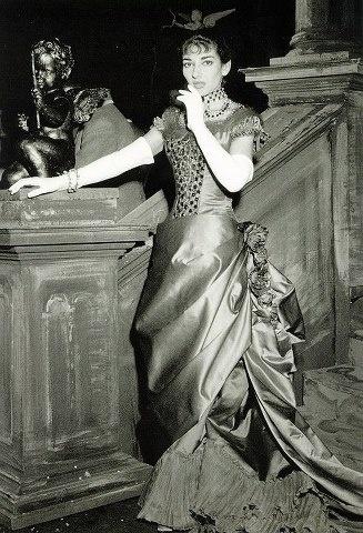 Violetta returns to Paris dressed in red satin... Maria Callas wears the designs of Vogue fashion illustrator and designer Lila de Nobili in La Traviata at La Scala, 1955.