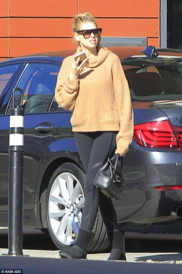 Charlotte McKinney wearing Versace Palazzo Empire Leather Shoulder Bag, UGG Classic Short Boots in Black and Lovers + Friends on the Road Sweater
