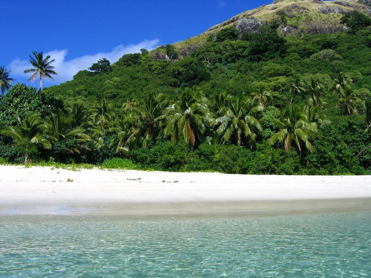 Mountain facing a white-sand beach in Fiji.