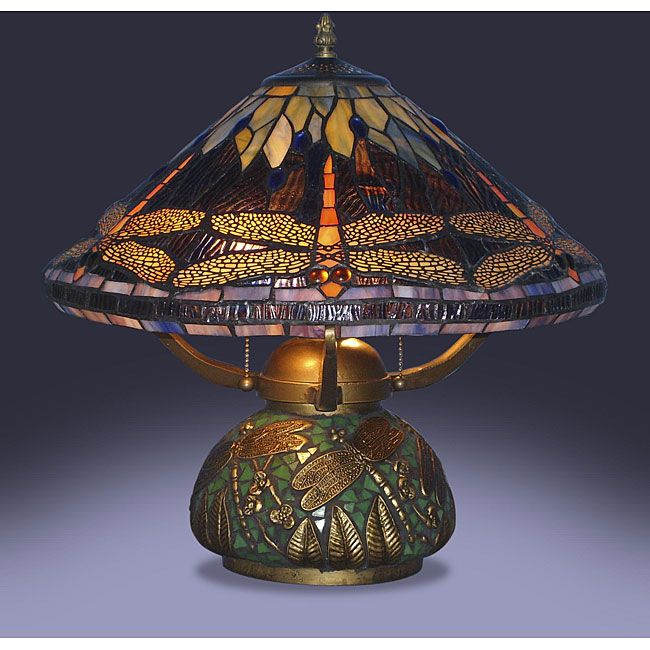 This gorgeous tiffany style dragonfly table lamp features artfully hand cut pieces of stained glass individually wrapped in fine copper foil for a