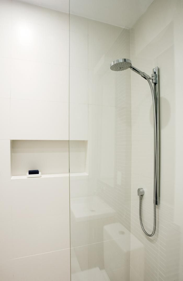 In the Minimalist style, all the bathroom fixtures including the shower are white.