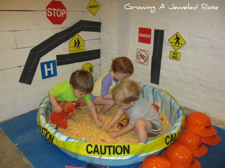 Sensory bins are usually small (like in a tupperware container) so you can put your hands in them, but why not make a really, really big one out of a kiddie pool? Pick a theme (this one is construction) and a base (this one uses dry corn kernels) and let your kids get their whole bodies in the bin!