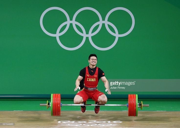 Zhiyong Shi of China celebrates after securing the gold medal during the Men's 69kg Group A Weightlifting contest on Day 4 of the Rio 2016 Olympic Games at the Riocentro - Pavilion 2 on August 9, 2016 in Rio de Janeiro, Brazil.