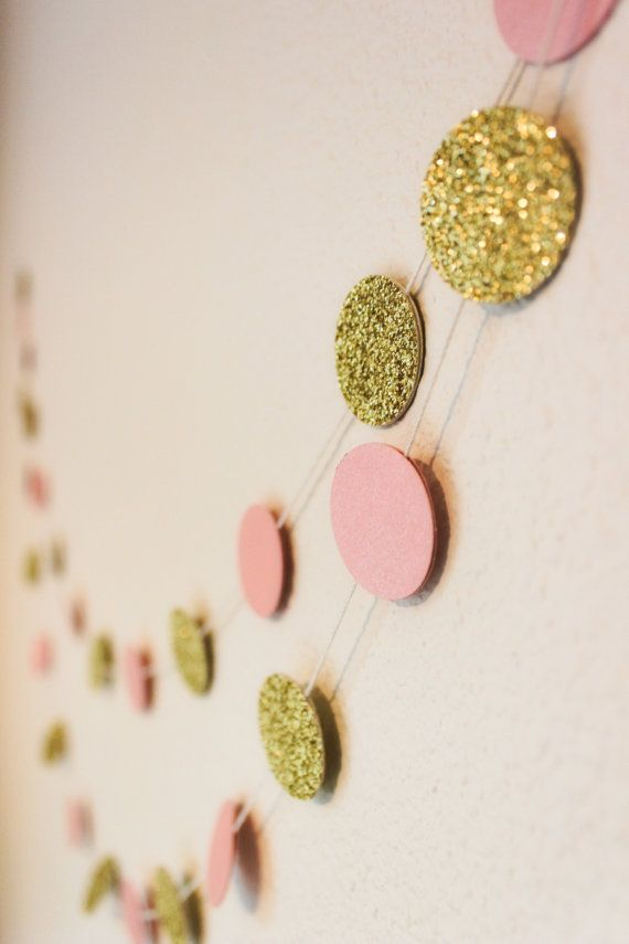 This perfectly matches the color theme I have going! I want vertical hanging chains in different sizes though :)   Gold and Blush Glitter Bokeh Paper Garland  by StellaArborBoutique, $8.50