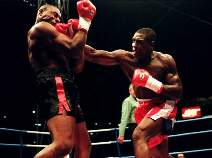 2 SEP 1995:  FRANK BRUNO OF GREAT BRITAIN HITS OLIVER MCCALL OF THE USA WITH RIGHT ON HIS WAY TO WINNING THE WBC HEAVYWEIGHT TITLE AT WEMBLEY STADIUM, LONDON. Mandatory Credit: John Gichigi/ALLSPORT