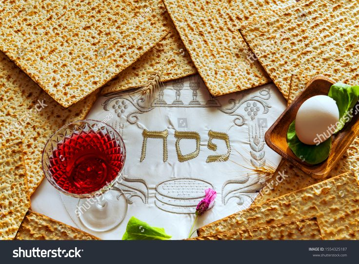 Unleavened bread food matzah and glass of red wine for