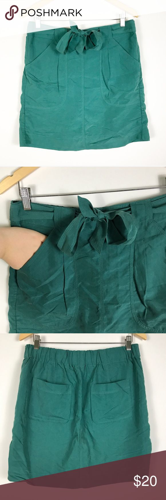 """Gap M teal tie front pocket skirt Gap M teal tie front pocket skirt. Measures approx 16.5"""" unstretched elastic waist 19.5""""h 18.5""""long laying flat. Great condition! GAP Skirts"""