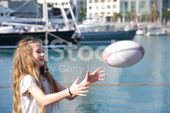 Girl catching Rugby Ball royalty-free stock photo