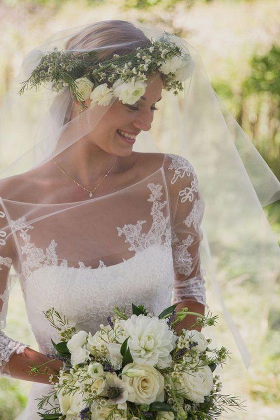 Beautiful sheer sleeve wedding dress with lovely neckline; Featured Photographer: Martina Wendland