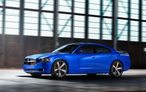 2013 Dodge Charger R/T Daytona by Mark Savage  Muscular Charger R/T Daytona offers kick-ass HEMI power. Click on the image to read more.