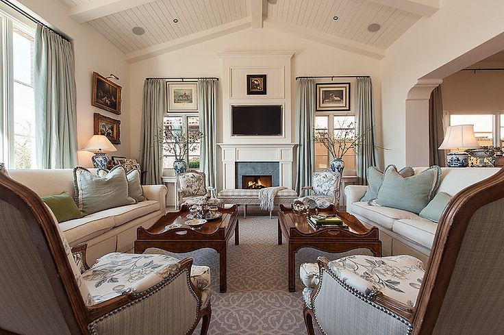 North Scottsdale Residence by Camelot Homes. Interesting paintings above windows below drapery rod and blue fireplace surround