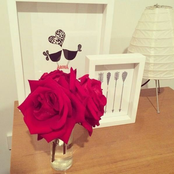 this is exactly what i need. white frames make everything so chic! and those roses? ♥