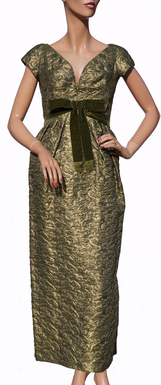 This is a fabulous 1960s era Paris couture gold lame / green brocade evening gown that was acquired from the estate of the wife of a wealthy financier and recipient of the Order of Canada. Her husband
