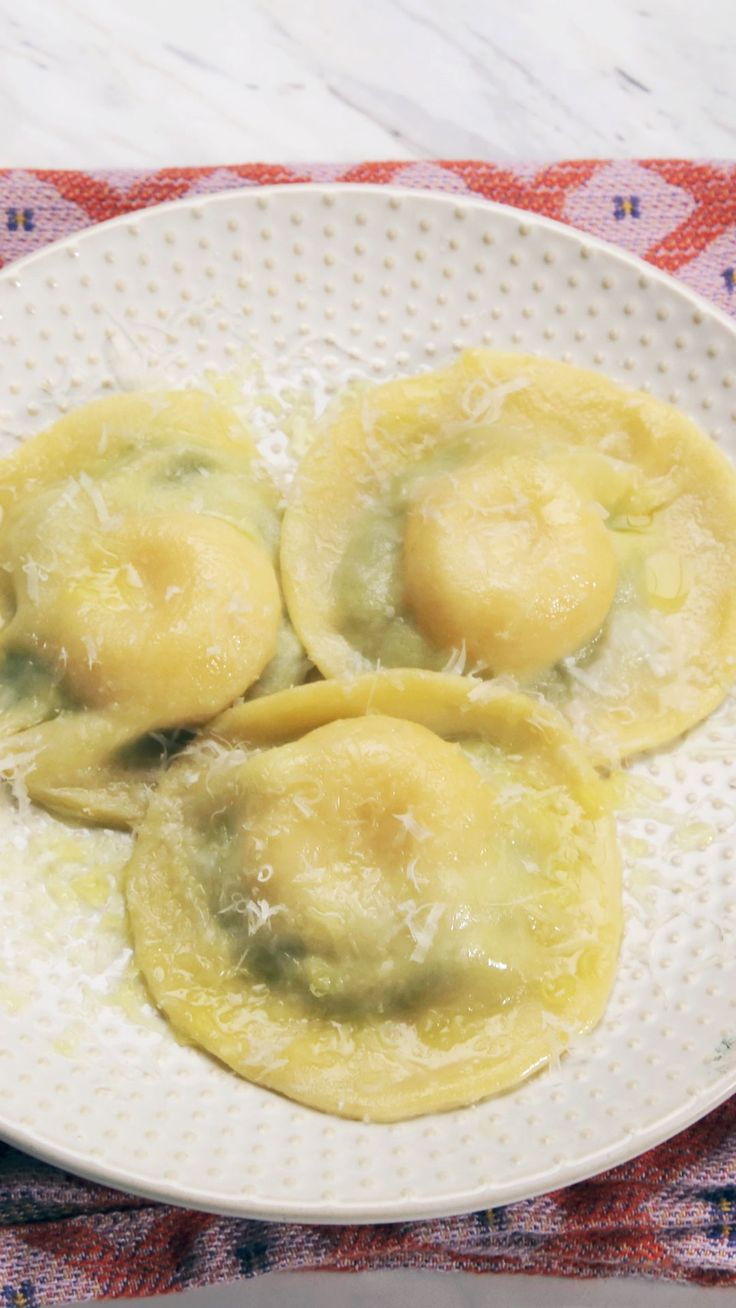 Stuffed with cheesy spinach and a runny egg yolk, this freshly made ravioli is perfect for brunch.