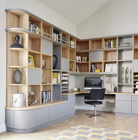 this grey modern study has been designed to fit perfectly with the flow of the room using curved edges
