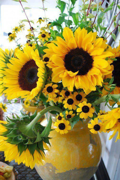 Sunflowers in a yellow vase.