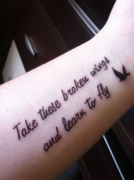 """Take these broken wings and learn to fly"" tatoo"