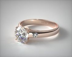 This contemporary 14K Rose Gold Cross Prong Diamond Accent Solitaire Ring has two bezel set round brilliant cut diamonds on each side of the center. A delicate accent to this fabulous ring.   Ring style # 11100R14 on JamesAllen.com. Click to see this ring in 360° HD!