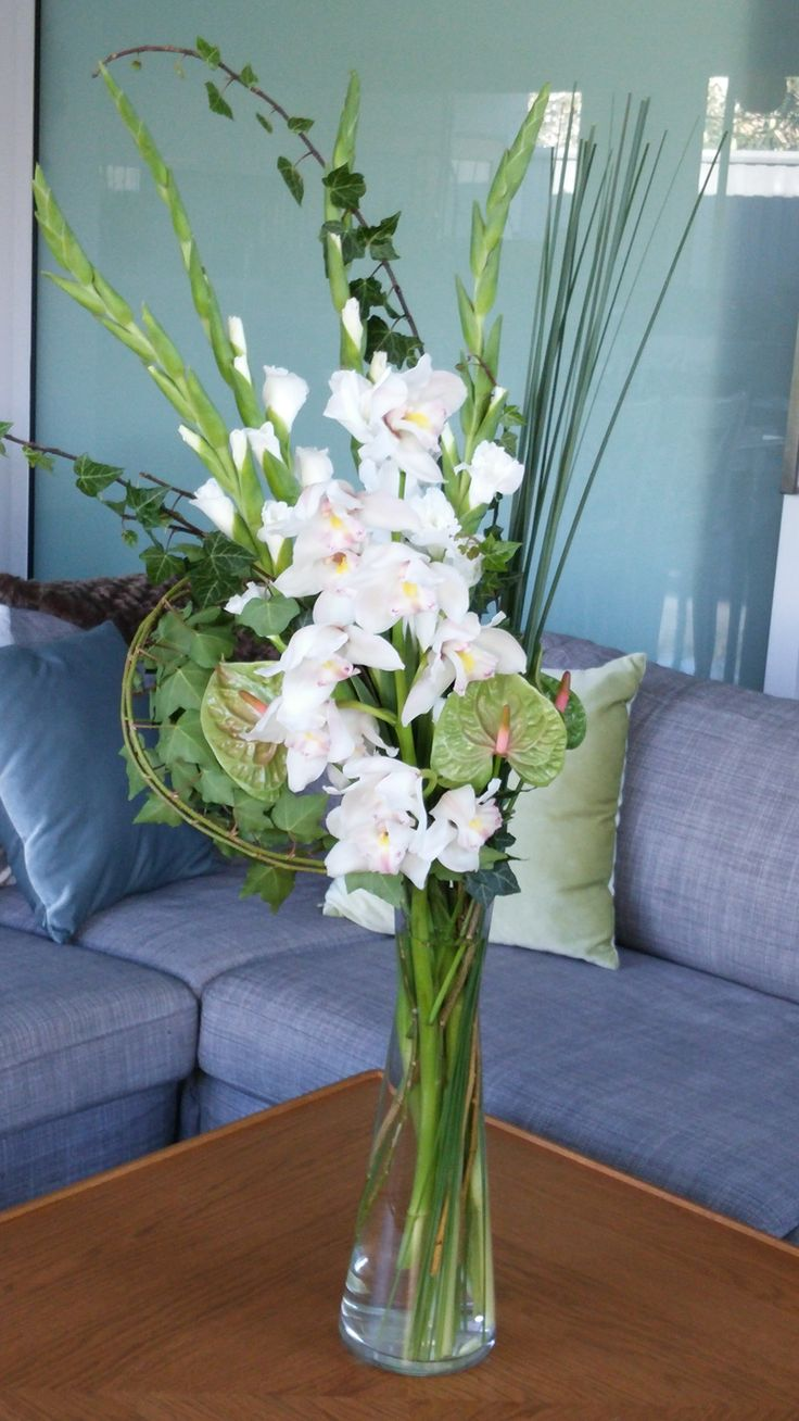 LARGE arrangement featuring orchids, anthuriums, blade grass, gladiolis and ivy.