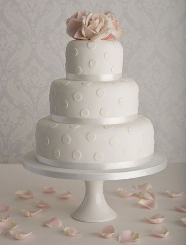 big fan of the simple, plain white cakes. polka dot pattern means it retains a fun feel though.