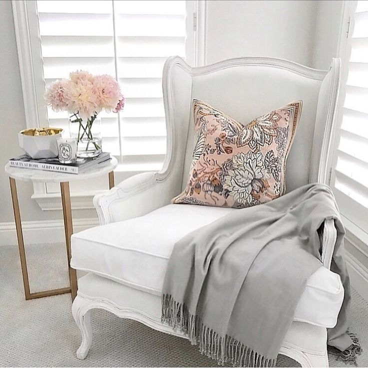 White French wingback arm chair Restoration Hardware, marble rose gold accent table, floral pillow, white decor, gold decor, classic gray paint Benjamin Moore, chantilly lace white paint Benjamin Moore, neutral decor, French decor, plantation shutters, reading nook, gray throw blanket, pink peonies (@thedecordiet) on Instagram