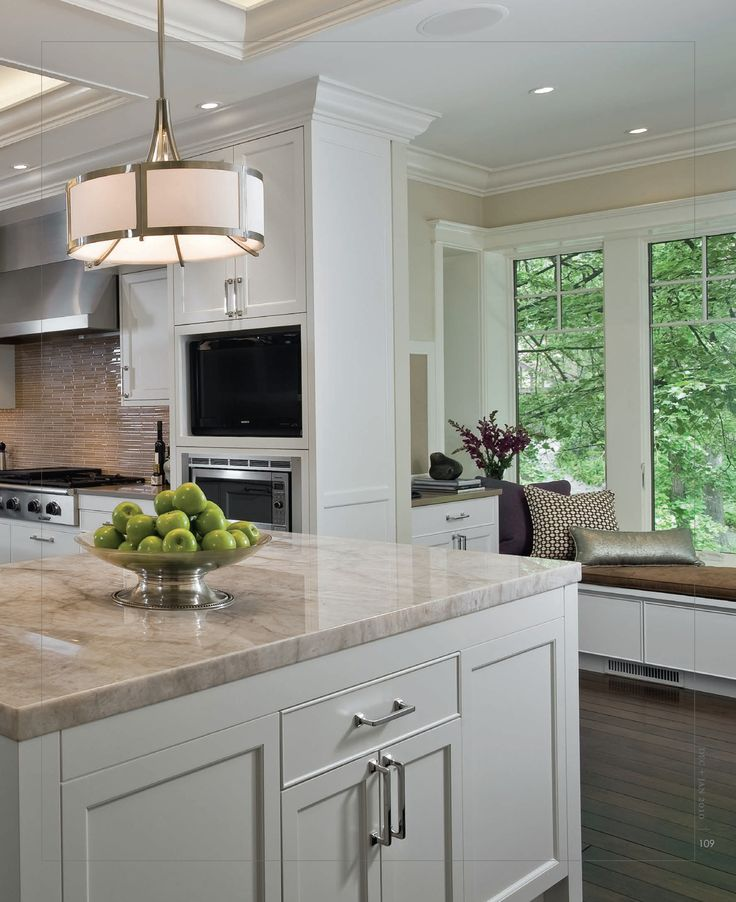 Love the color of these counter tops with the white cabinets