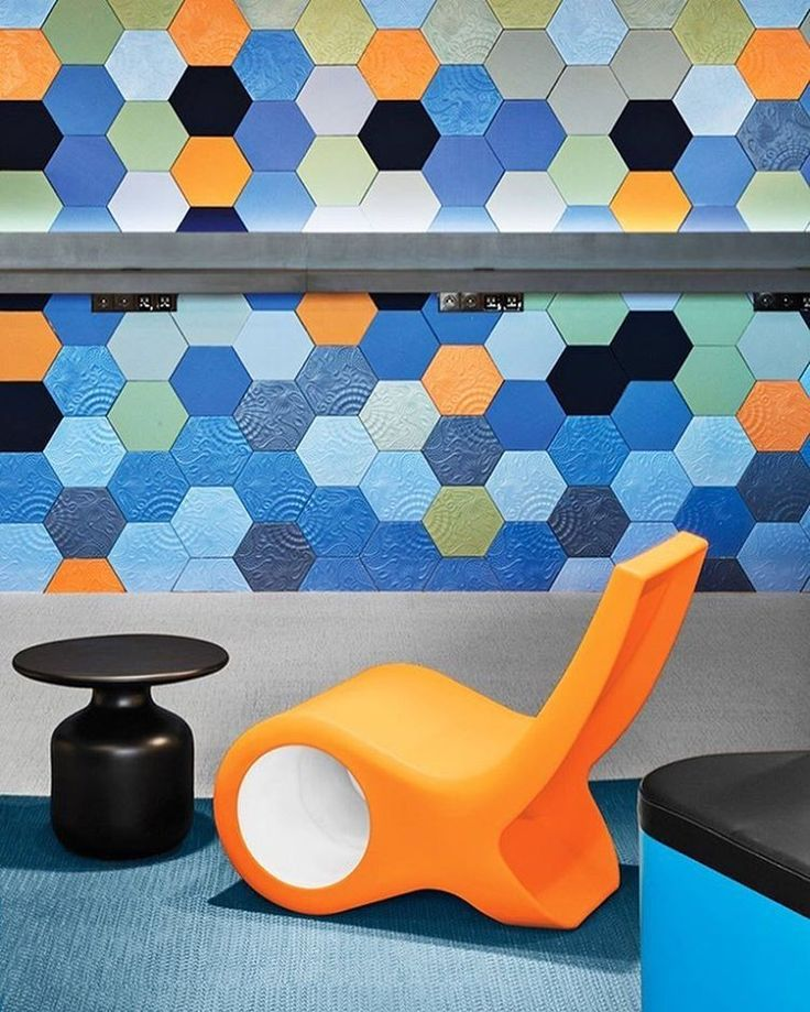 Vibrantly colored wall tiles at Microsoft's AECOM-designed headquarters in Barcelona replicate Antoni Gaudi's reliefs on local sidewalks and allude to the nearby Mediterranean's coastal glow. Photography by Manolo Yllera. #architecture #interiors #design #interiordesign #office #microsoft #barcelona... - Interior Design Ideas, Interior Decor and Designs, Home Design Inspiration, Room Design Ideas, Interior Decorating, Furniture And Accessories