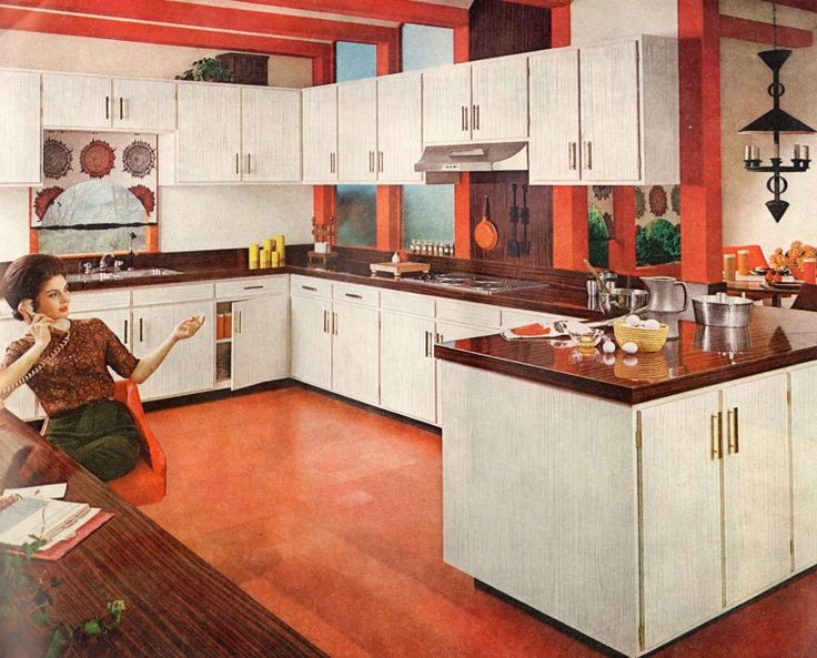 1960s era kitchen cabinets with slab doors and modern, clean, linear hardware
