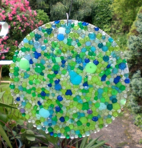 Light catcher made from melted plastic beads - what about making small discs to use for jewelry?