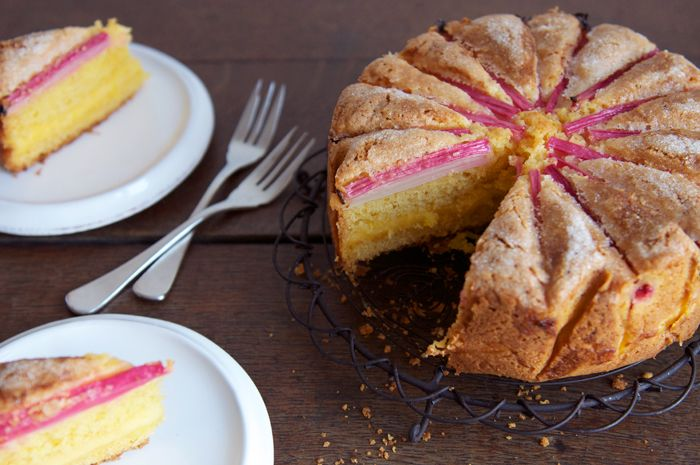 Delicious and impressive-looking rhubarb cake with a layer of custard baked through the centre.