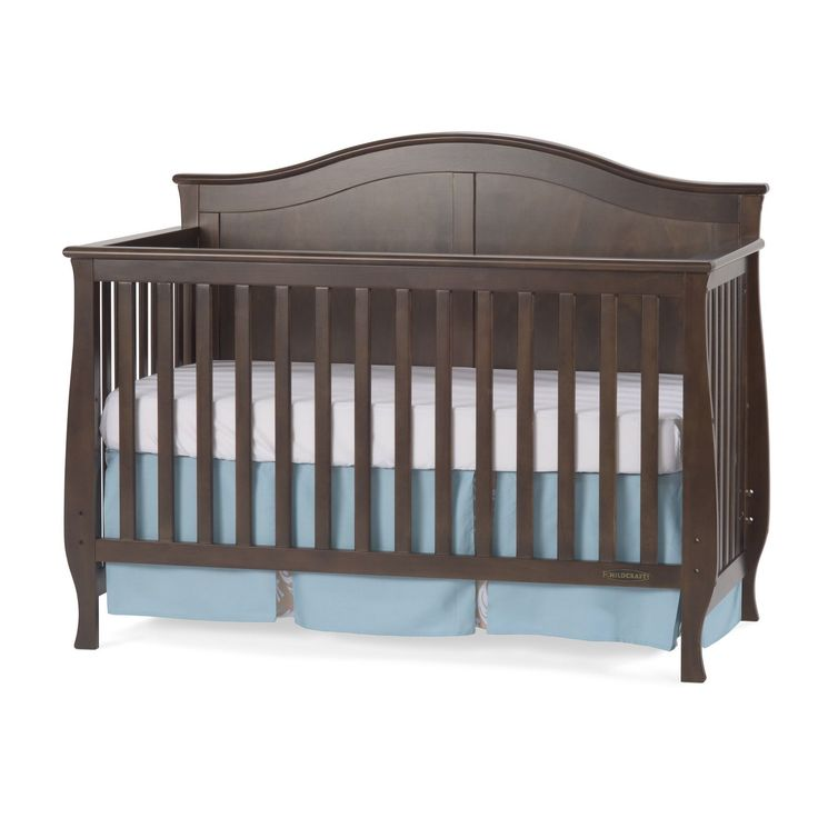 Featuring A Soft Arched Top Detailed Cap Rails And Flared Legs This Crib