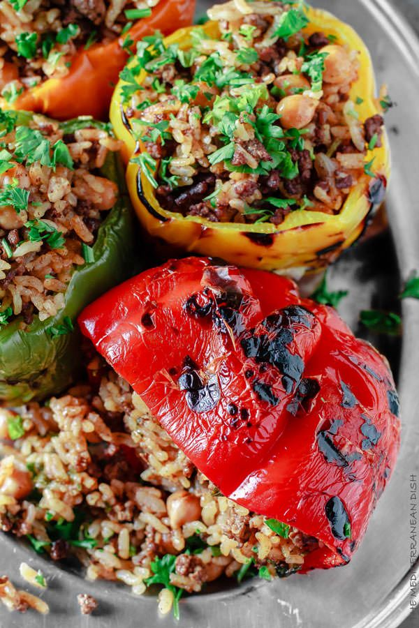 Easy Mediterranean stuffed bell pepper recipe with step-by-step photos! Charred peppers stuffed w/ rice, spiced beef, chickpeas & fresh herbs. Delicious!