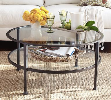 Less Volume With The Glass, But Still Has Some Heft With The Darker Metal  Tanner Round Coffee Table With Glass Top