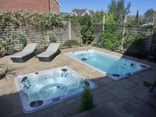 Hydropool swim spa and hot tub installed into a stone - How to put hot water in a swimming pool ...