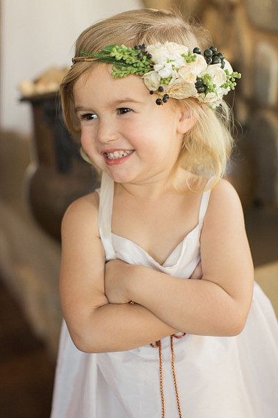 Floral Crown: Who says flower girls have to carry an arrangement? Trade in the bouquet for a festive headpiece. Photo by Carlie Statsky Photography via Style Me Pretty