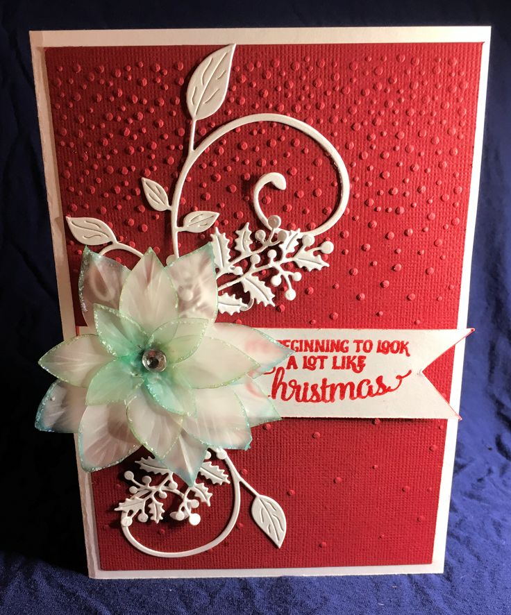 Another poinsetta card, this time the flower is made of vellum. I added die cut leaves. The flower was cut out using Stampin up festive flower builder punch