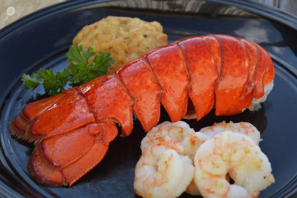 Three elegant seafood dinners, ready to prepare! Two of our Canadian lobster tails set the stage for a fabulous supper for two. Add 2 packages of our wild Gulf white shrimp and 2 Chesapeake crab cakes