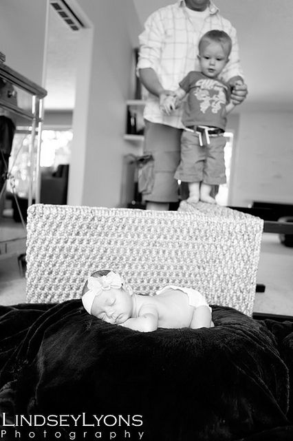 A newborn shoot for my niece at my house my son was super interested in