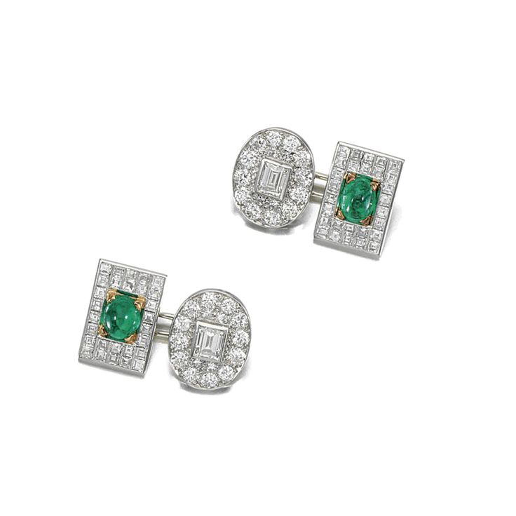 PAIR OF EMERALD AND DIAMOND CUFFLINKS Each composed of one oval plaque and one rectangular plaque, respectively set with a step-cut diamond within a surround pavé-set with brilliant-cut stones, the other centring on a cabochon emerald within a border of carré-cut diamonds, case by HOLMES, 29, OLD BOND ST. LONDON, W.1.