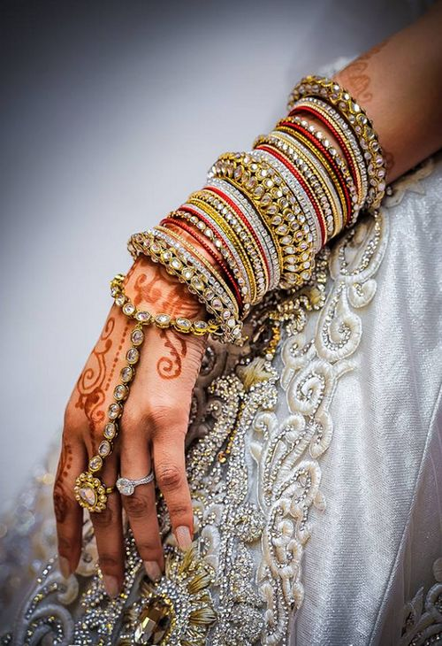 Photo by:Zamana Lifestyles white and gold and red bangles..Gold bangles with mehndi...What more could you ask for?
