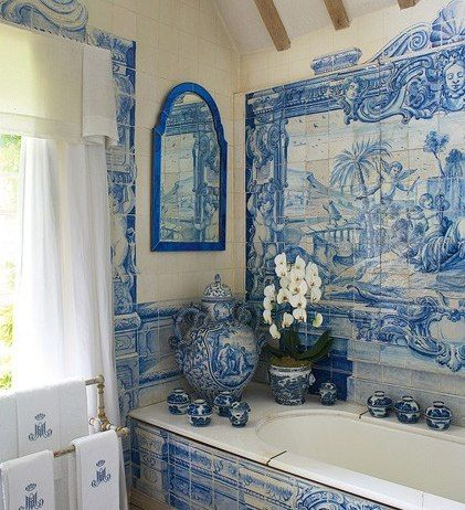 Anouska Hempel's English country  house. The room's vanity is covered in trompe l'oeil tiles painted by Kaffe Fassett according to a Hempel design. Photo: Architectural Digest.