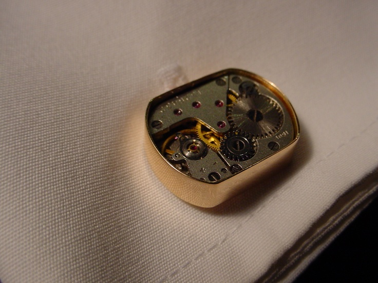 "The ""Mechanical Cufflink"" made by the EuWaWo.  Tiny genuine mechanical movement cased in solid rosé gold."