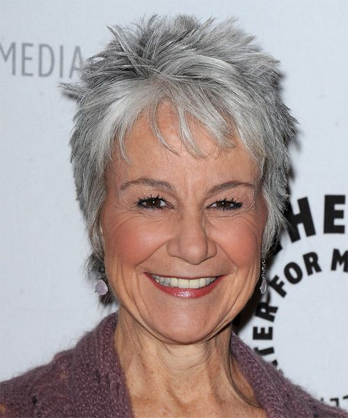 Andrea Romano hairstyle - The sides and back of this do are tapered into the back and sides blending into the top layers that are jagged or razor cut to achieve a textured look and feel.