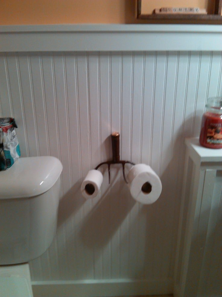 I bought this old pitch fork for $2 at a yard sale and turned it into a toilet paper holder for my bathroom.  I sprayed clear shellac on it and bought a bronze garden hose cap to cover the top.