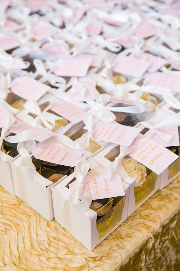 Cupcakes in white cupcake boxes were wonderful take-home wedding favors for guests! | Pink Wedding in Florida | Claudette Montero Photography