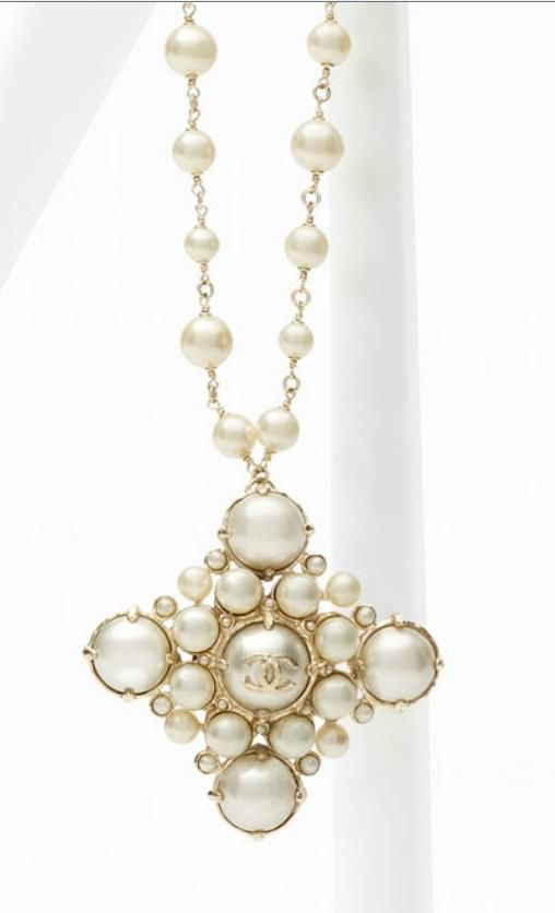 Chanel S/S 2013- Necklace embellished with medallion in metal and glass pearls.