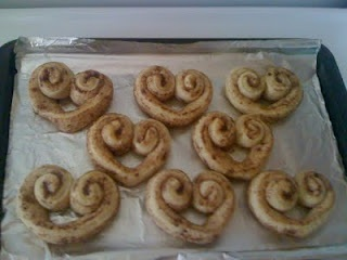heart shape cinnamon rolls from a can- use red food coloring in the icing :)