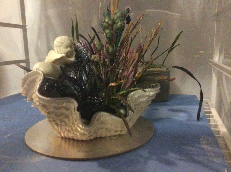 Sugar vase and floral arrangement. Grasses nuts berries